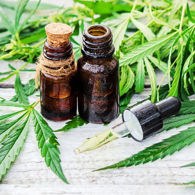CBD Oils and Cannabis Leafs